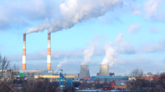 Smoking pipes of thermal power plant on blue sky Stock Footage