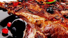 Grilled baby ribs on plate Stock Footage