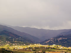 Village in mountain valley fog hides. Sicily, Italy. Time Lapse. 4x3 Stock Footage