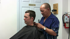 Middle Aged Male Getting a Haircut Stock Footage