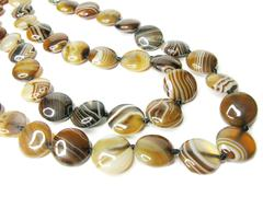 brown and white agate mineral beads - stock photo