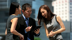 Ethnic Business Team Outside Modern City Buildings Stock Footage