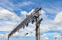 Forefront of a railway catenary with a blue sky Stock Photos