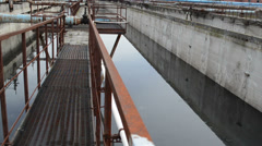 Rusty sewage water treatment plant equipment dirty water basin Stock Footage