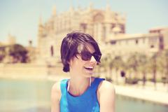 Laughing young woman holidaying in mallorca Stock Photos