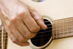 Playing guitar Stock Photos