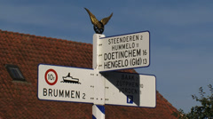Nostalgic direction sign in Dutch countryside  + zoom out village - stock footage