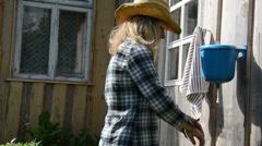 Gardener girl woman wash hands under rural plastic washer tool Stock Footage