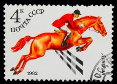 USSR - CIRCA 1982: A stamp printed in USSR, horse riding, jockey Stock Photos