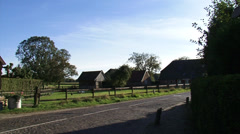 BRONKHORST village, Cobbled street, pasture  + pan Dutch countryside Stock Footage
