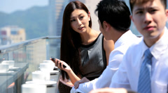 Young Asian Chinese Share Brokers Smart Phone Office Rooftop - stock footage