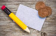 Stock Photo of coins with pencil and  paper card