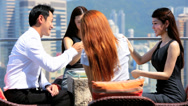 Stock Video Footage of Young Asian Chinese Share Brokers Rooftop Restaurant Panoramic View