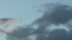 Two airplane practicing aerobatics Stock Footage