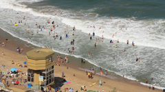Lifeguard tower and bathers in the sea Stock Footage