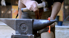 A blacksmith forging a horseshoe Stock Footage