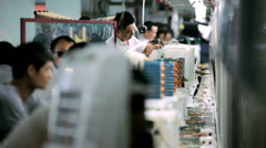 Assembly line factory workers, China, Asia - stock footage