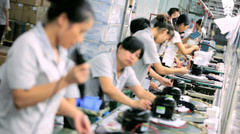 Female factory worker assembling product, China - stock footage
