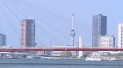 High buildings beyond Willemsbrug red bridge - Rotterdam Stock Footage