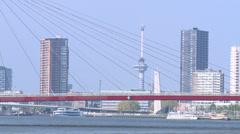 Stock Video Footage of High buildings beyond Willemsbrug red bridge - Rotterdam