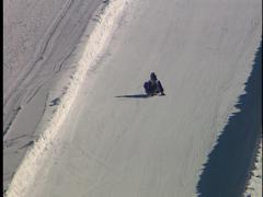 Man goes down ski hill on shovel - stock footage