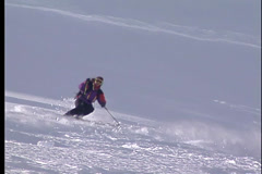 Skier carves smoothly down the mountainside Stock Footage