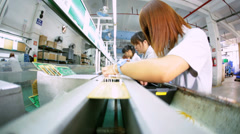Chinese skilled female workers producing PCB boards, China - stock footage