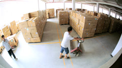 Chinese workers working in large storage warehouse, China - stock footage