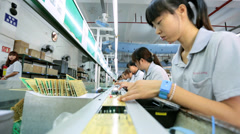 Workers manufacturing PCB boards for electronic equipment, China - stock footage