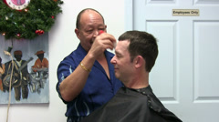 Barber Brushing Off Client After Haircut Stock Footage