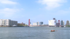 Small boat rowing away - Rotterdam Stock Footage