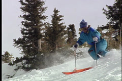 Vintage Skier turns and burns down mountain Stock Footage