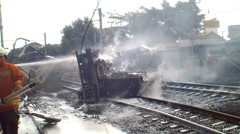 Train Hit Oil Tank Truck in Jakarta Stock Footage