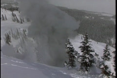 Vintage snow avalanche bombing Stock Footage