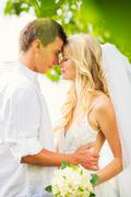 Bride and groom, romantic newly married couple embracing, just married Stock Photos