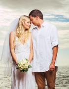bride and groom, romantic newly married couple on the beach, just married - stock photo