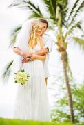 bride and groom, romantic newly married couple holding hands, just married - stock photo