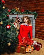 Girl in red dress christmas tree Stock Photos