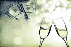 Glasses with champagne over holiday background Stock Photos
