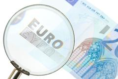 Scrutinizing the euro Stock Photos