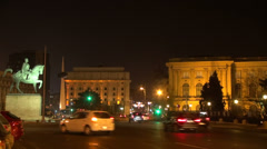 Traffic, Bucharest old city street, Romania, palace square by night, Art museum Stock Footage