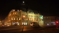 Central University Library, Bucharest, Romania, traffic by night, architecture Stock Footage
