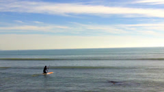 Surfer Paddles Out Into Small Wave Surf- Doheny State Beach CA Stock Footage