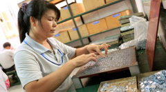 Chinese factory worker on assembly line, Mainland China - stock footage