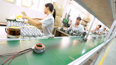 Chinese female factory worker sorting product items, China Stock Footage