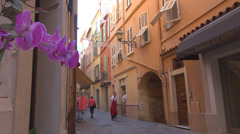 Stock Video Footage of Tourist passing visit old town monaco city urban travel day colorful narrow