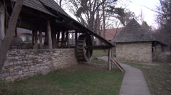 Old water mill in traditional village, architecture, open air museum, zoom in Stock Footage