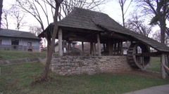 Old water mill in traditional Romanian village, architecture, open air museum Stock Footage