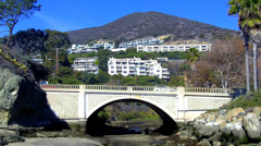 Aliso Creek And Bridge With Hillside Dwellings- Laguna Beach CA - stock footage