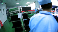 Quality control checks by Chinese worker on PCBs, China Stock Footage